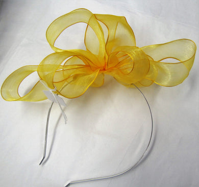 Handcrafted yellow bow fascinator on a hair band or hair clip