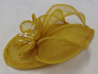 Handcrafted yellow flower fascinator on a hair band or hair clip