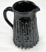 Handcrafted beautiful ceramic pouring jugs