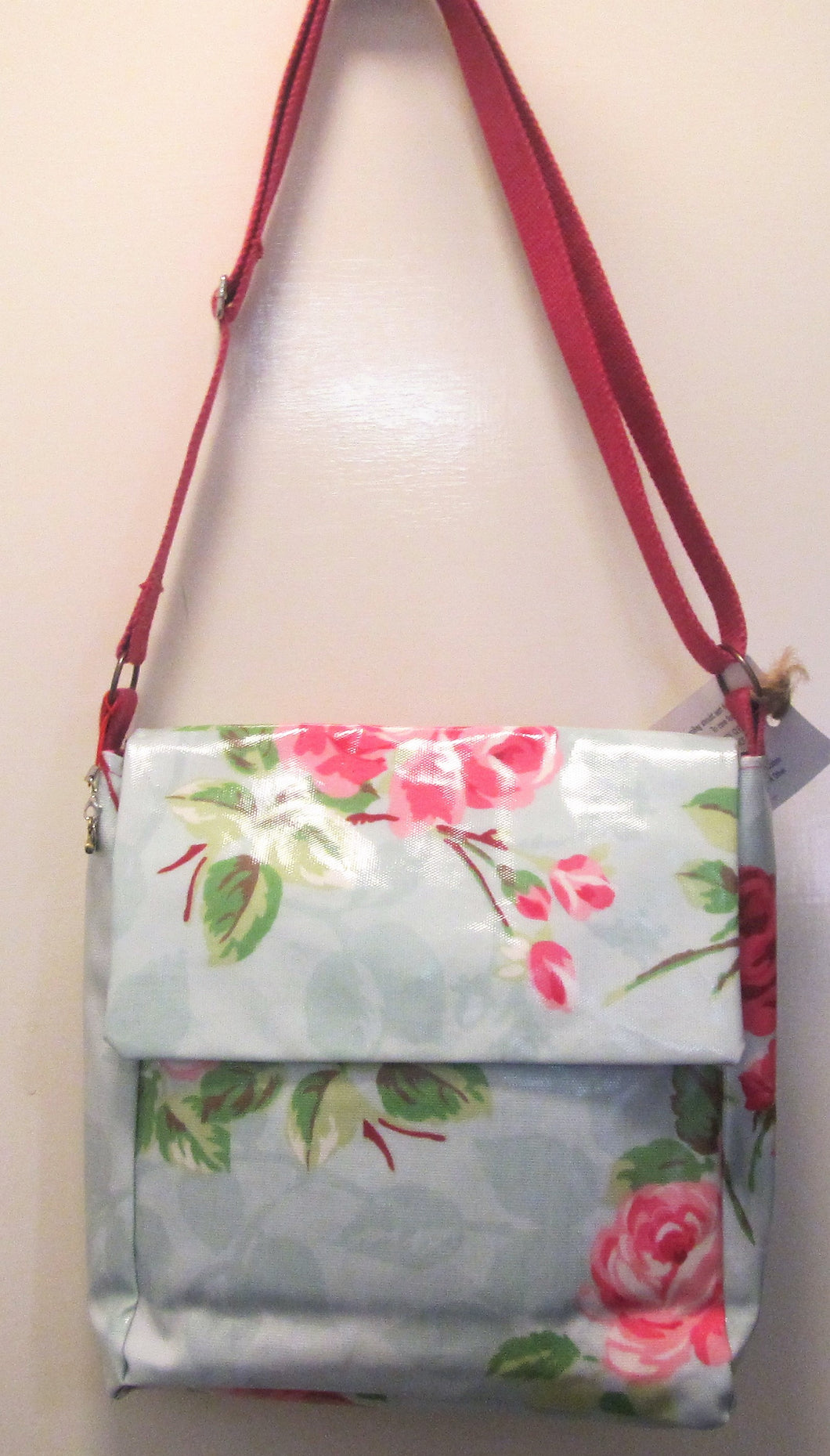 Beautiful handcrafted blue and pink floral wax fabric messenger bag