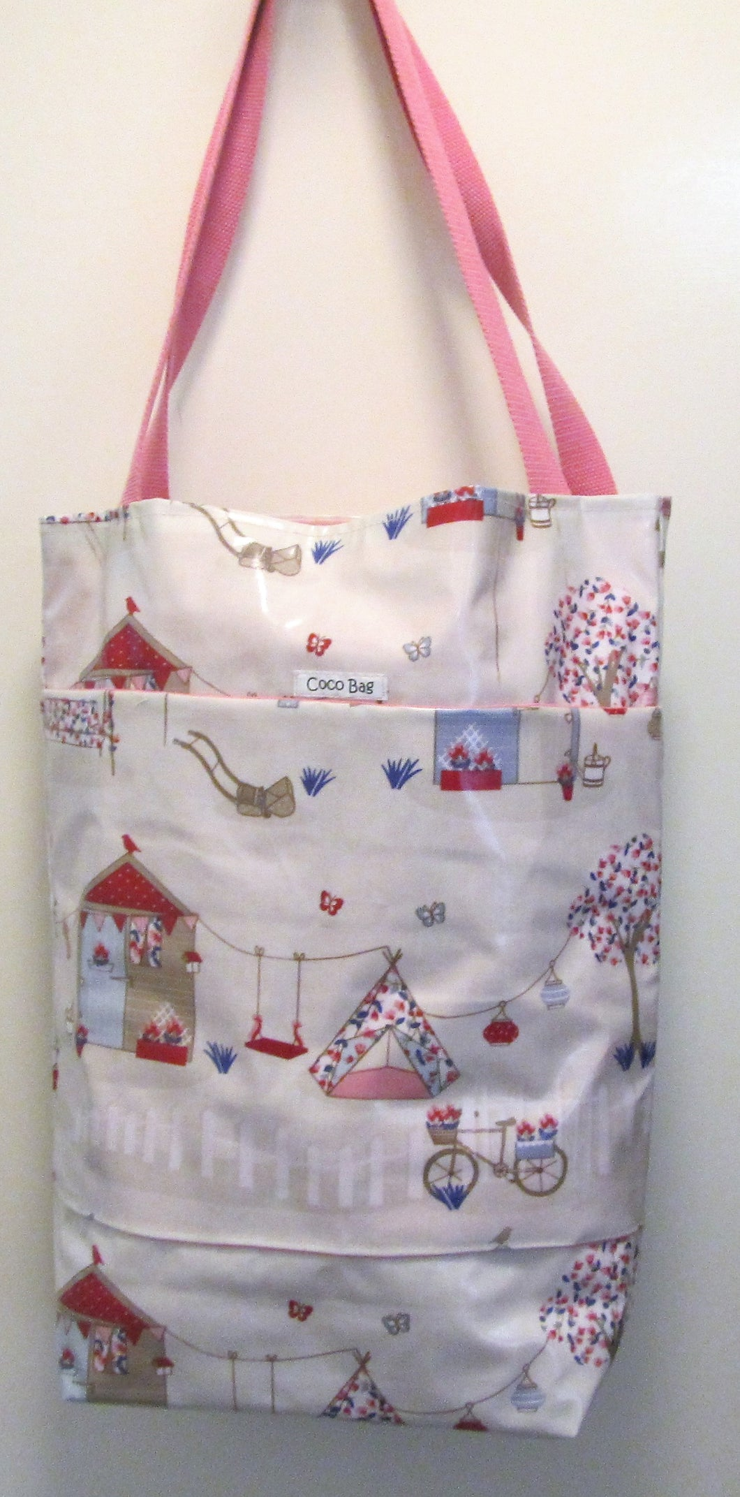 Beautiful handcrafted garden themed wax fabric beach bag with two handles