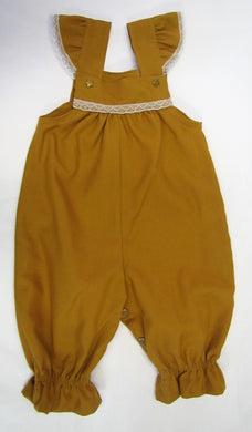 Handcrafted mustard star fully lined romper 6-9 months