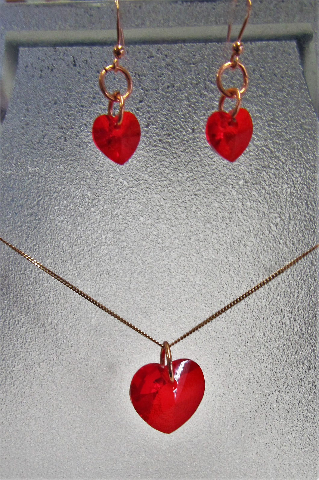 Handcrafted swarovski Crystal red hearts on rose gold plated necklace and earring set