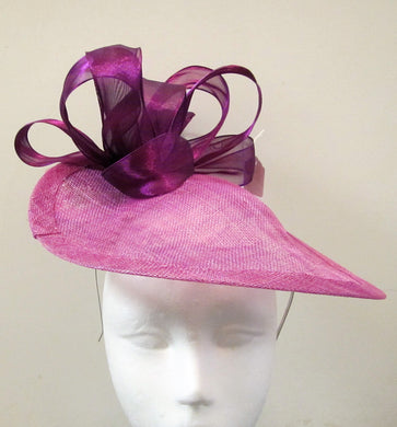 Handcrafted light purple disk fascinator with purple bow and flowers on a headband