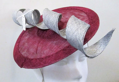Handcrafted wine disk fascinator with silver spiral on a headband