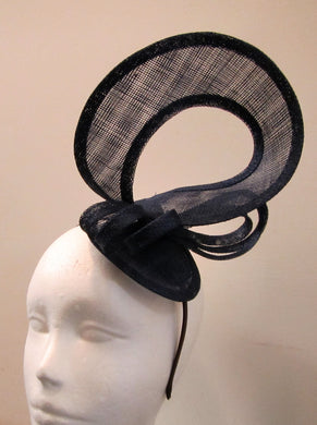 Handcrafted navy blue twist fascinator with bow on a headband