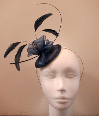 Handcrafted small blue flower and feather fascinator on a headband