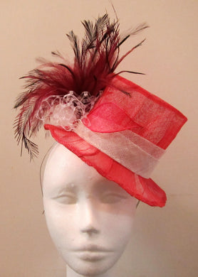 Handcrafted fuchsia pink top hat fascinator with feathers on a hair band