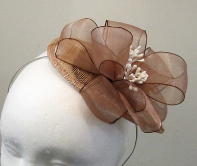 Handcrafted small beige bow  fascinator  on a hair band