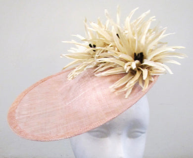 Handcrafted beige turned up disk with cream flowers fascinator on a headband