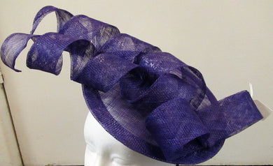 Handcrafted purple disk with spirals and bow fascinator on a headband