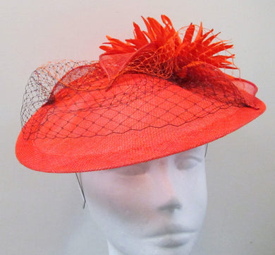 Handcrafted burnt orange  disk with cream flowers and netting fascinator on a headband