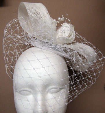 Handcrafted Bridal hair piece bow with roses and pearls with netting on a hair band