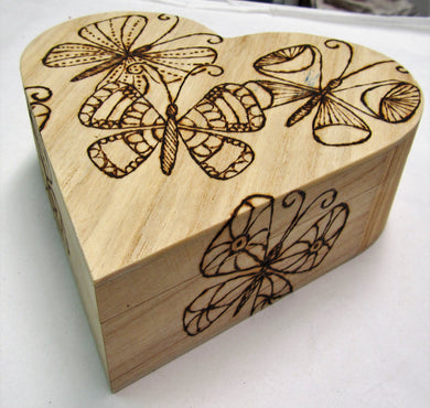 Wooden heart shaped box with various pyrography detail