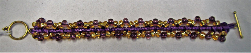 Beaded bracelet handmade with Gold and purple beads