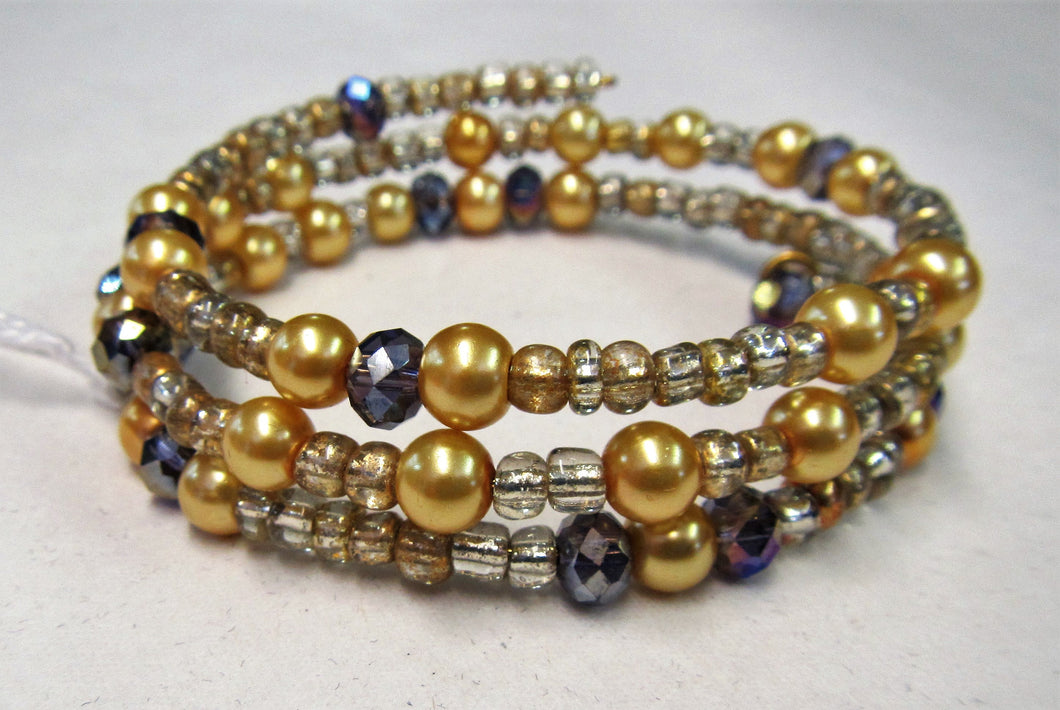 Beaded bracelet handmade with Gold, purple and clear beads
