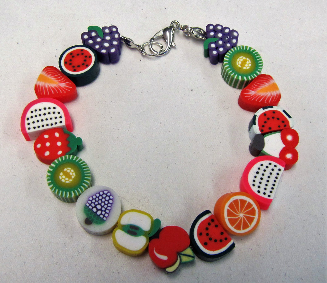 Bracelet with a variety of fruit on an elasticated band