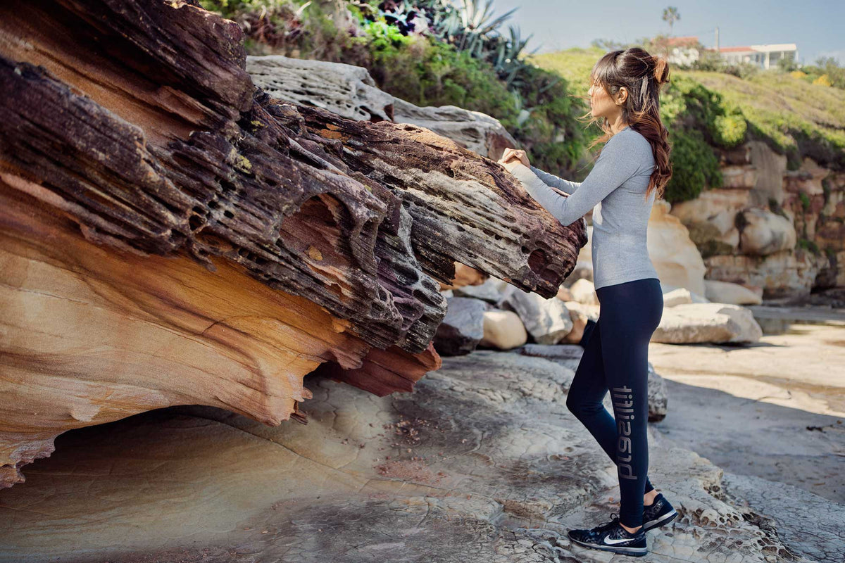 Brasilfit Hero Image 2_2017.  Model is wearing Brasilfit Activewear logo leggings in black and Q long sleeve top.
