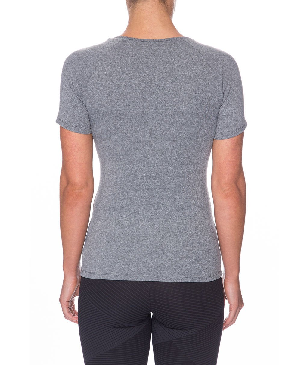 Front view product image with model for Brasilfit activewear Q T-shirt in gray.  The Q T-shirt is part of our basics activewear collection that is focused on performance, high compression activewear.