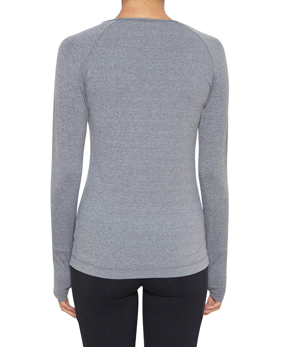 Front view product image with model for Brasilfit activewear Q long sleeve t-shirt in gray.  The Q long sleeve T-shirt is part of our basics activewear collection that is focused on performance, high compression activewear.