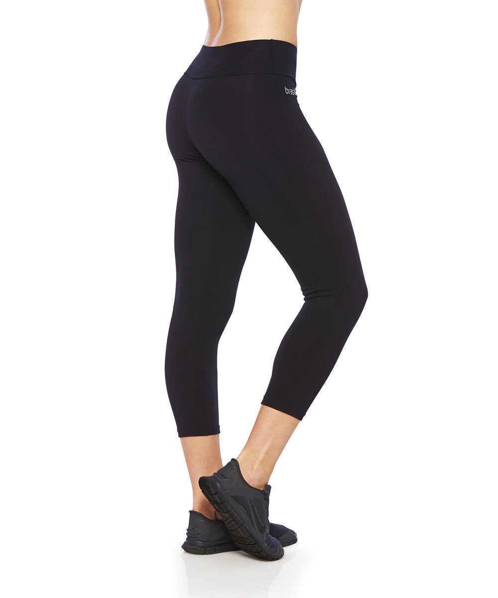 Side view product image for Brasilfit Emana calf length activewear leggings. Brasilfit Emana fabric helps reduce celluite. Emana leggings are part of our essentials and basics activewear collection that is focused on high compression, performance activewear.