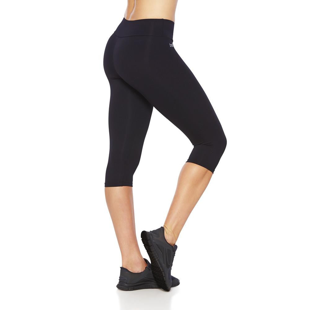 Side view product image for Brasilfit Emana under knee activewear leggings. Brasilfit Emana fabric helps reduce celluite. Emana leggings are part of our essentials and basics activewear collection that is focused on high compression, performance activewear.