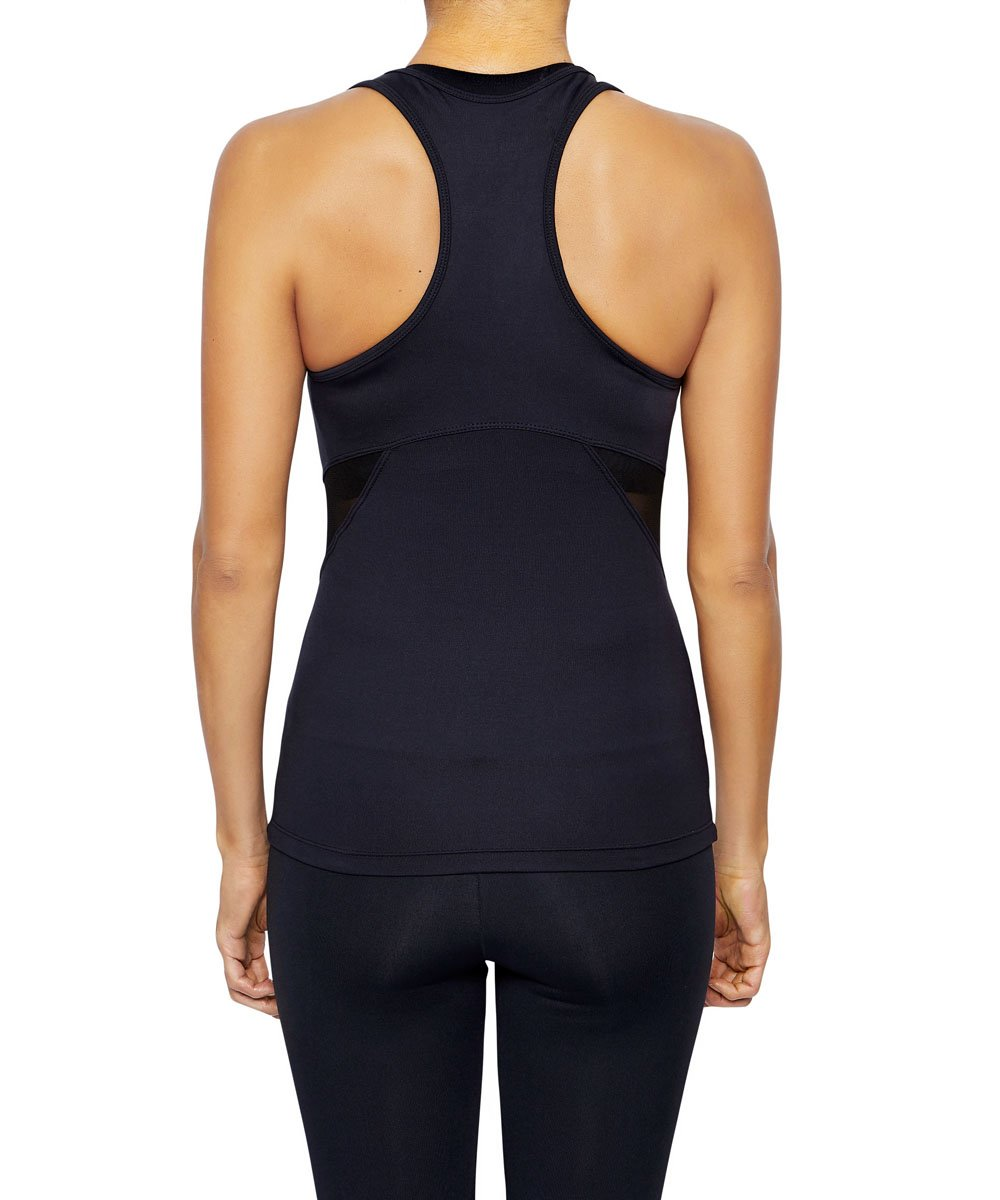 Front view product image with model for Brasilfit activewear mesh Osaka singlet in black.  The Osaka singlet is part of our basics activewear collection that is focused on performance, high compression activewear.