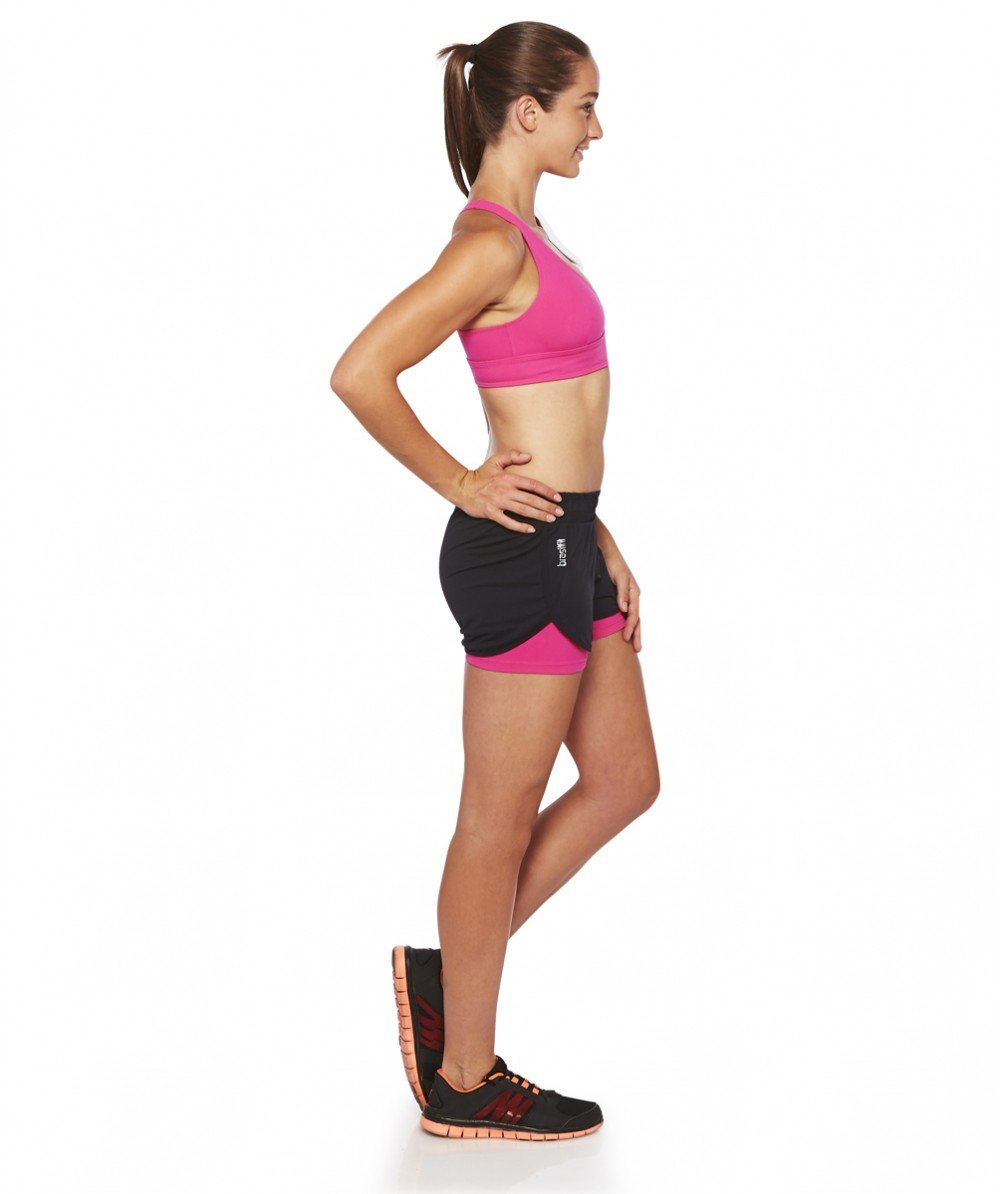 Front view product image with model for Brasilfit Ilheus activewear crop top in pink.  The Ilheus Crop top is part of our basics activewear collection that is focused on performance, high compression activewear.