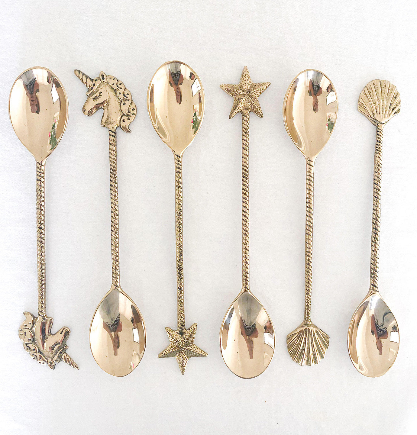 gold brass spoons