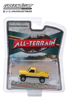 GreenLight 1:64 All-Terrain Series 9 - 1987 GMC High Sierra - Colonial Yellow and Black 35150-C