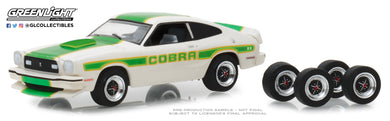 GreenLight 1/64 The Hobby Shop Series 5 - 1978 Ford Mustang II Cobra II - White with Green Billboard Stripes and Spare Tires 97050-E