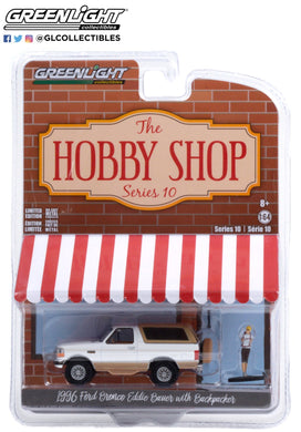 GreenLight 1:64 The Hobby Shop Series 10 - 1996 Ford Bronco Eddie Bauer with Backpacker - Oxford White and Light Saddle 97100-F