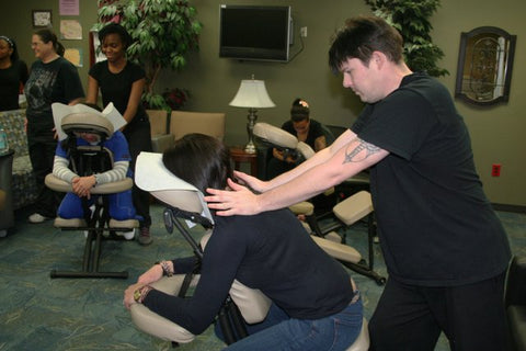 chair massage therapy reduces headaches on corporate employees