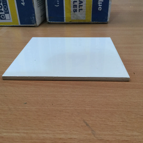 Bab0391 - two boxes of white square tiles