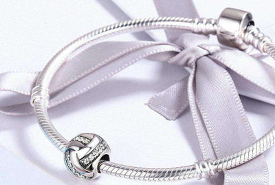 Glittering Ribbon Ball Shape CZ Charm