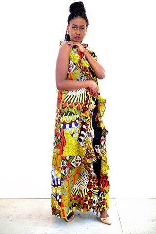 Duster African Print Dutch Wax Ankara Kimono Jacket in London. This  ruffle neck Floor Length wax print aztec african print sleevless jacket is an essential need for your beach holiday this summer. Its hand made with 100% ankara cotton prints in multicolour of red, yellow and white