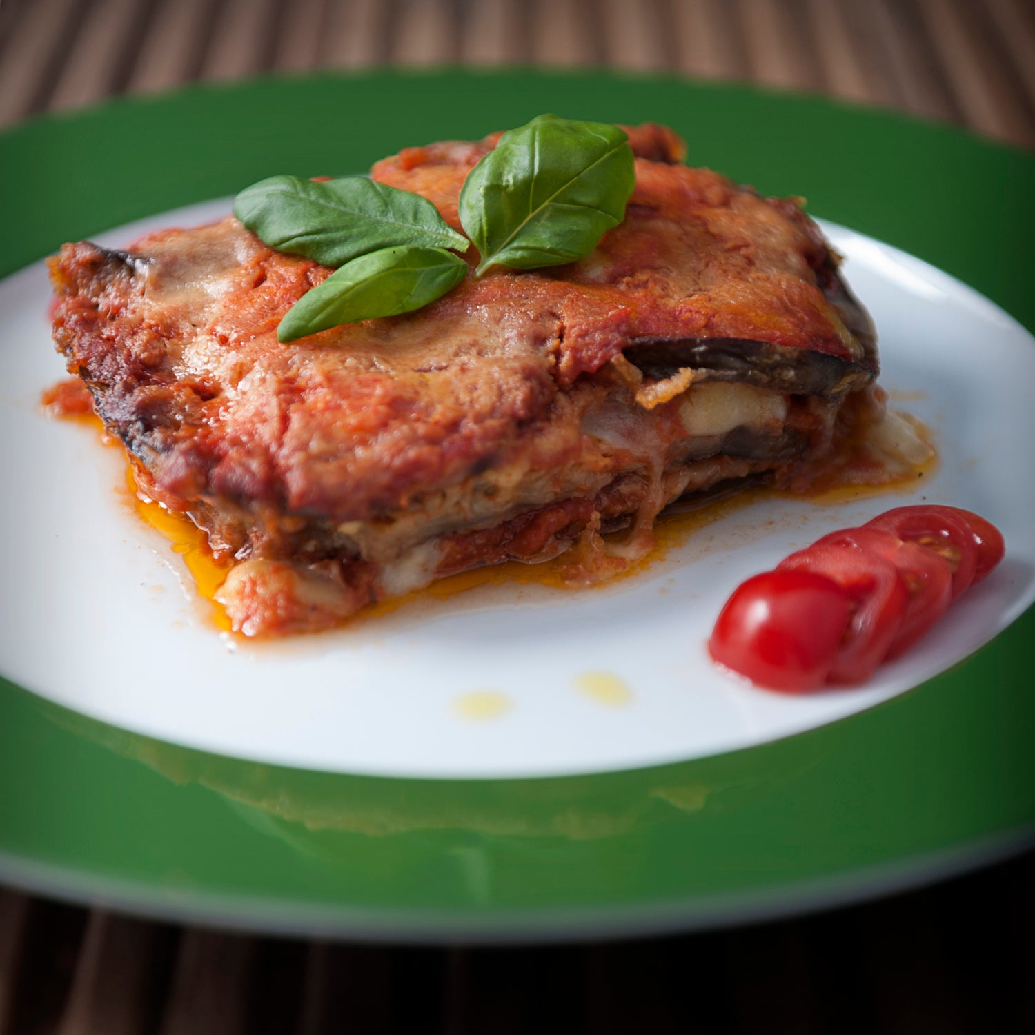 Parmigiana of Aubergine with mozzarella, tomato sauce and Grana Padano
