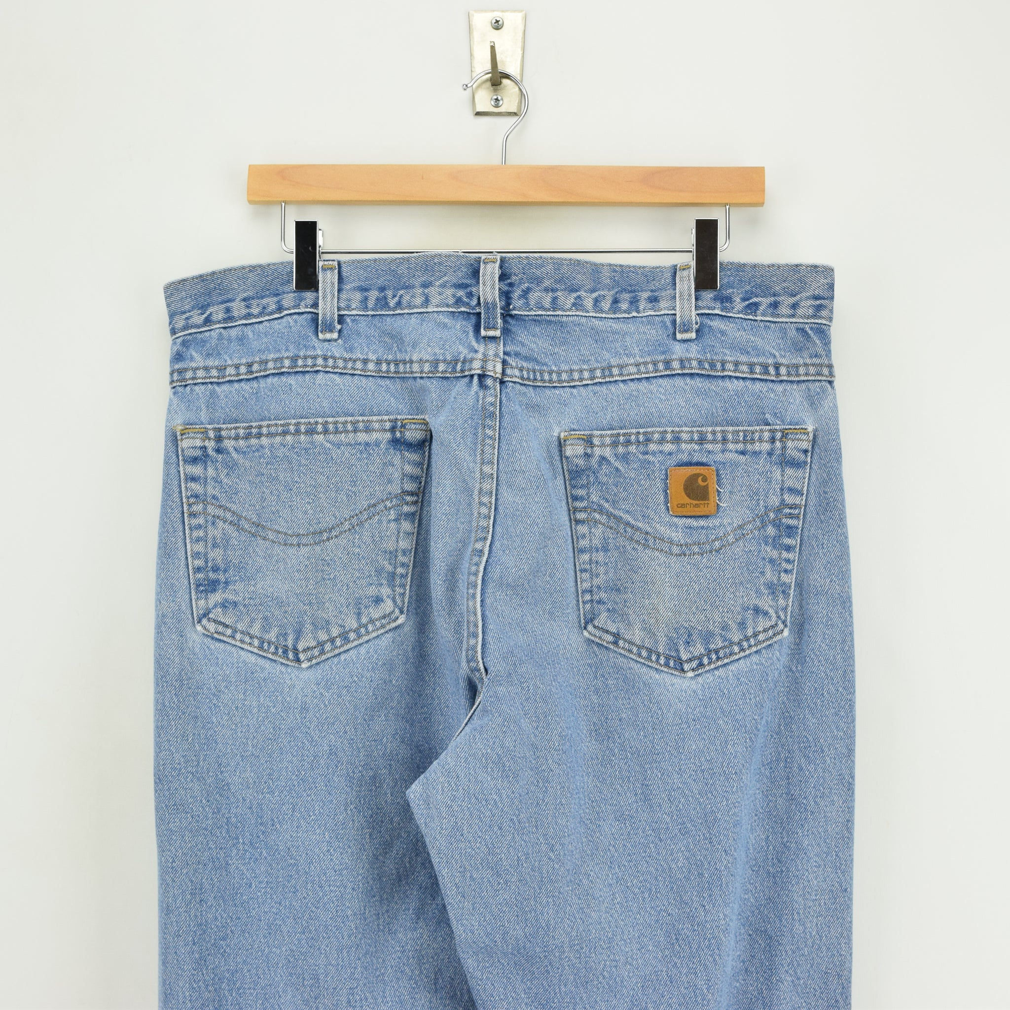 Vintage Carhartt Blue Denim Jeans Work Pants 34 W 32 L back pocket waist badge