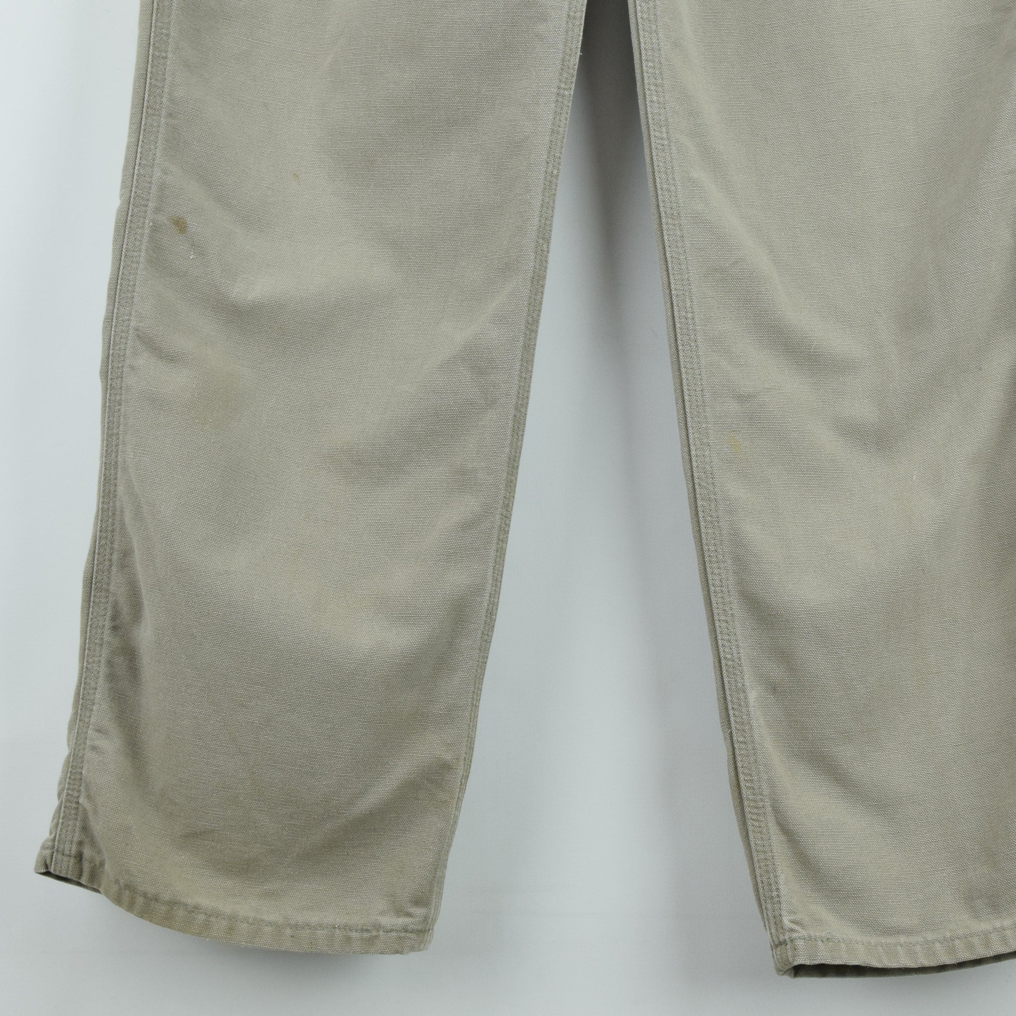 Vintage Carhartt Stone Duck Canvas Utility Work Cargo Pant 32 W 34 L front hem