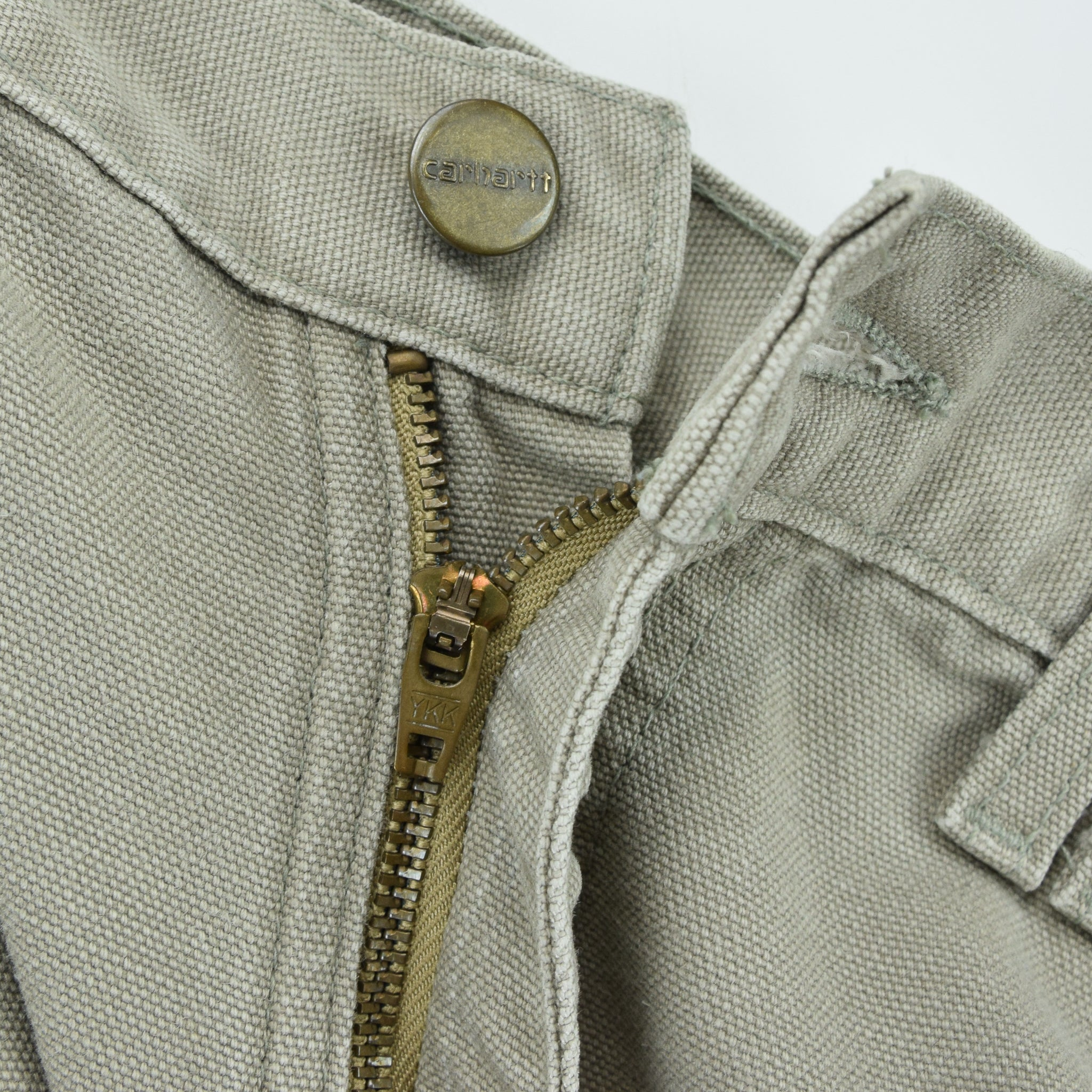 Vintage Carhartt Stone Duck Canvas Utility Work Cargo Pant 32 W 34 L zip front fastening