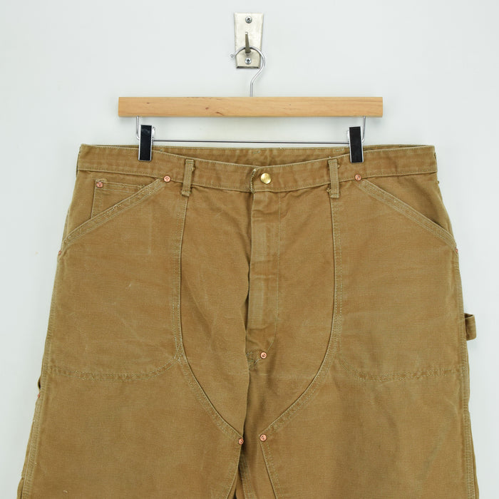 Vintage Carhartt Brown Carpenter Duck Canvas Utility Work Pant 36 W 28 L front waist