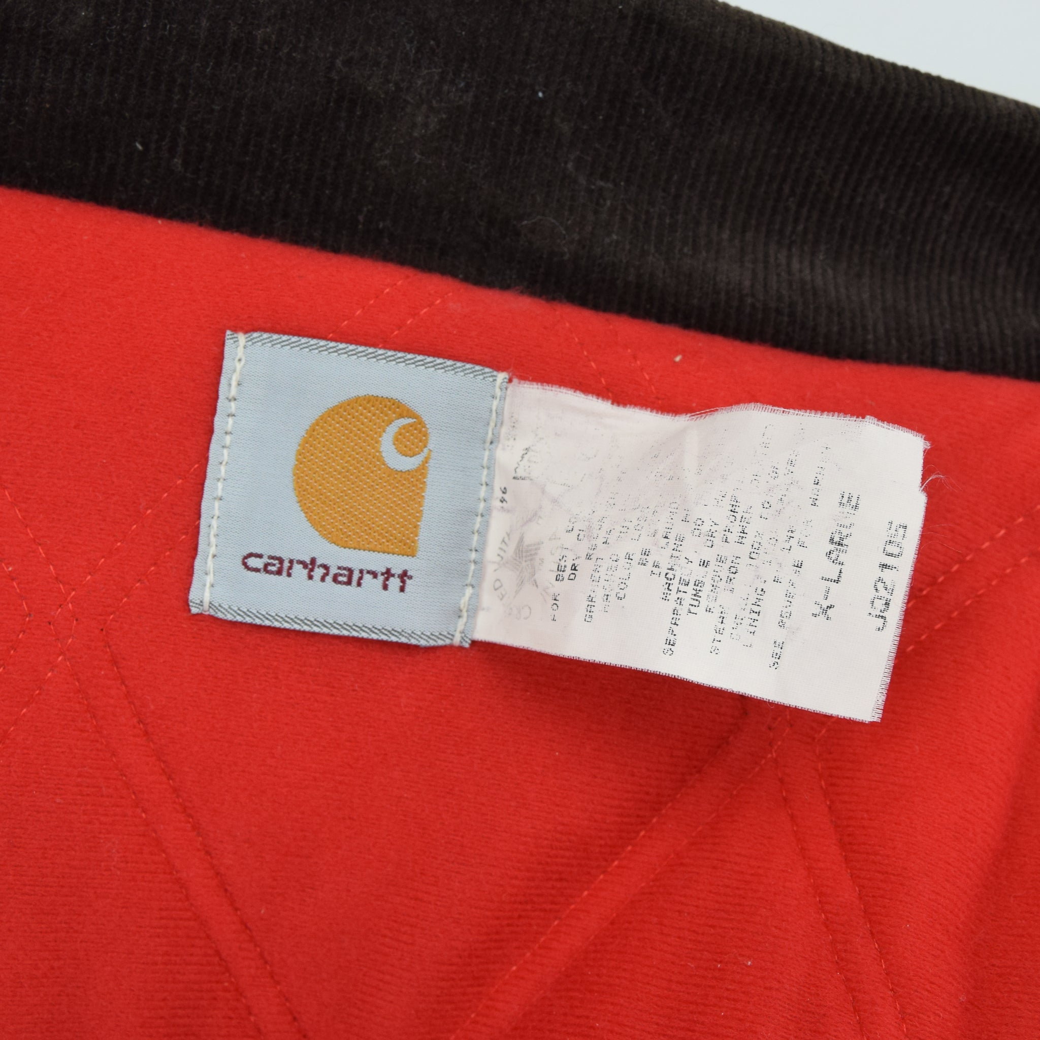 Vintage Carhartt Duck Canvas Quilt Lined Black Bomber Jacket Made in USA XL label
