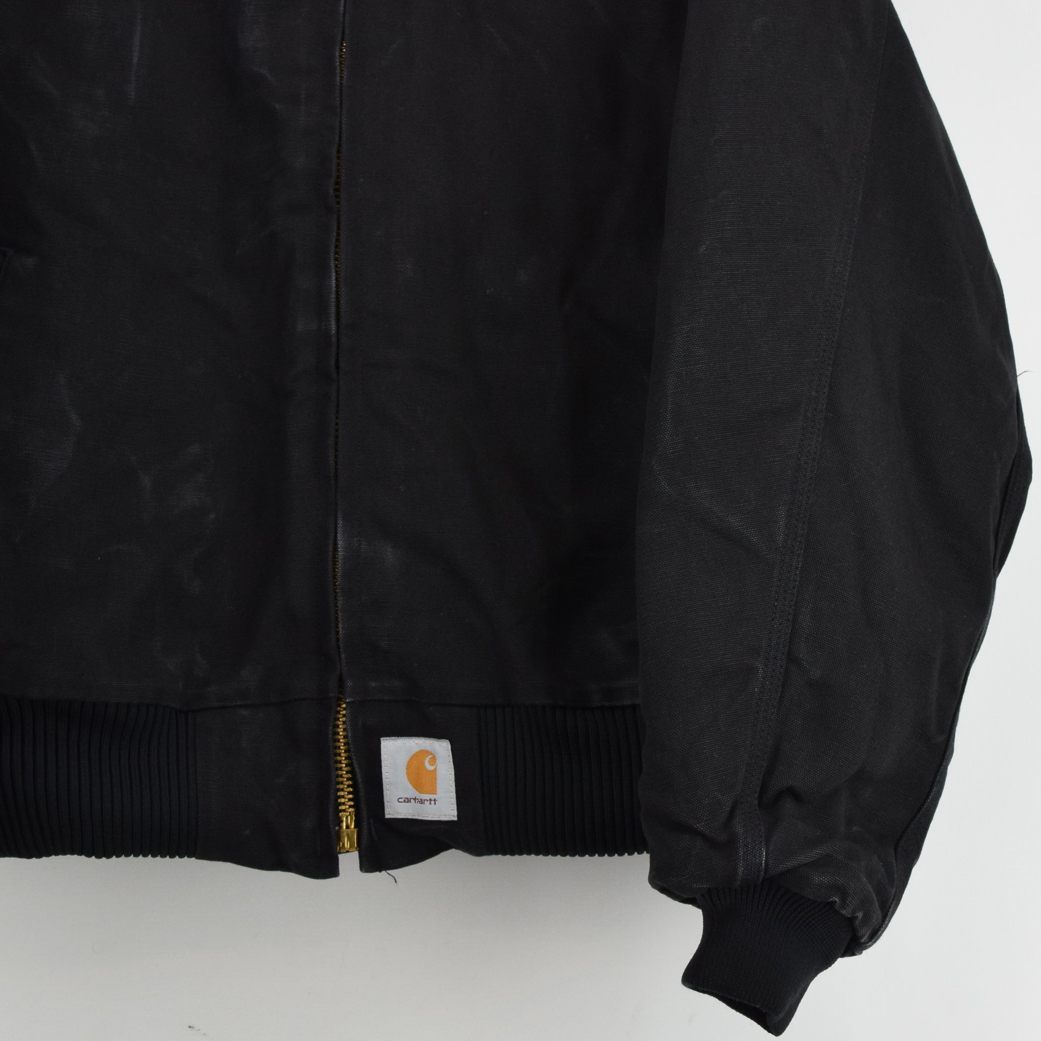 Vintage Carhartt Duck Canvas Quilt Lined Black Bomber Jacket Made in USA XL front hem