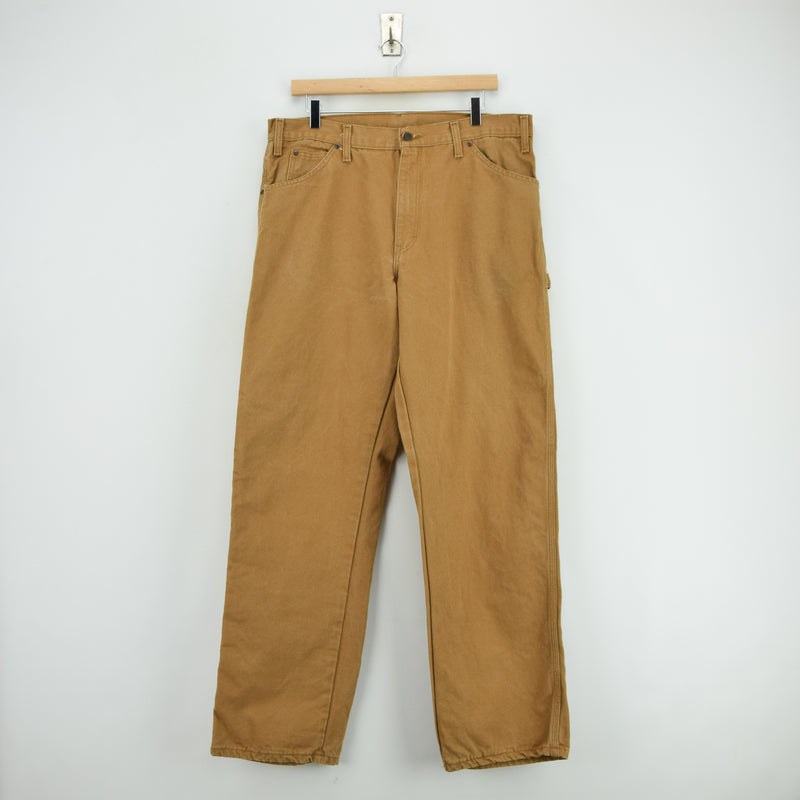 Vintage Dickies Workwear Brown Duck Canvas Work Pants Utility Trousers 34 W 32 L front