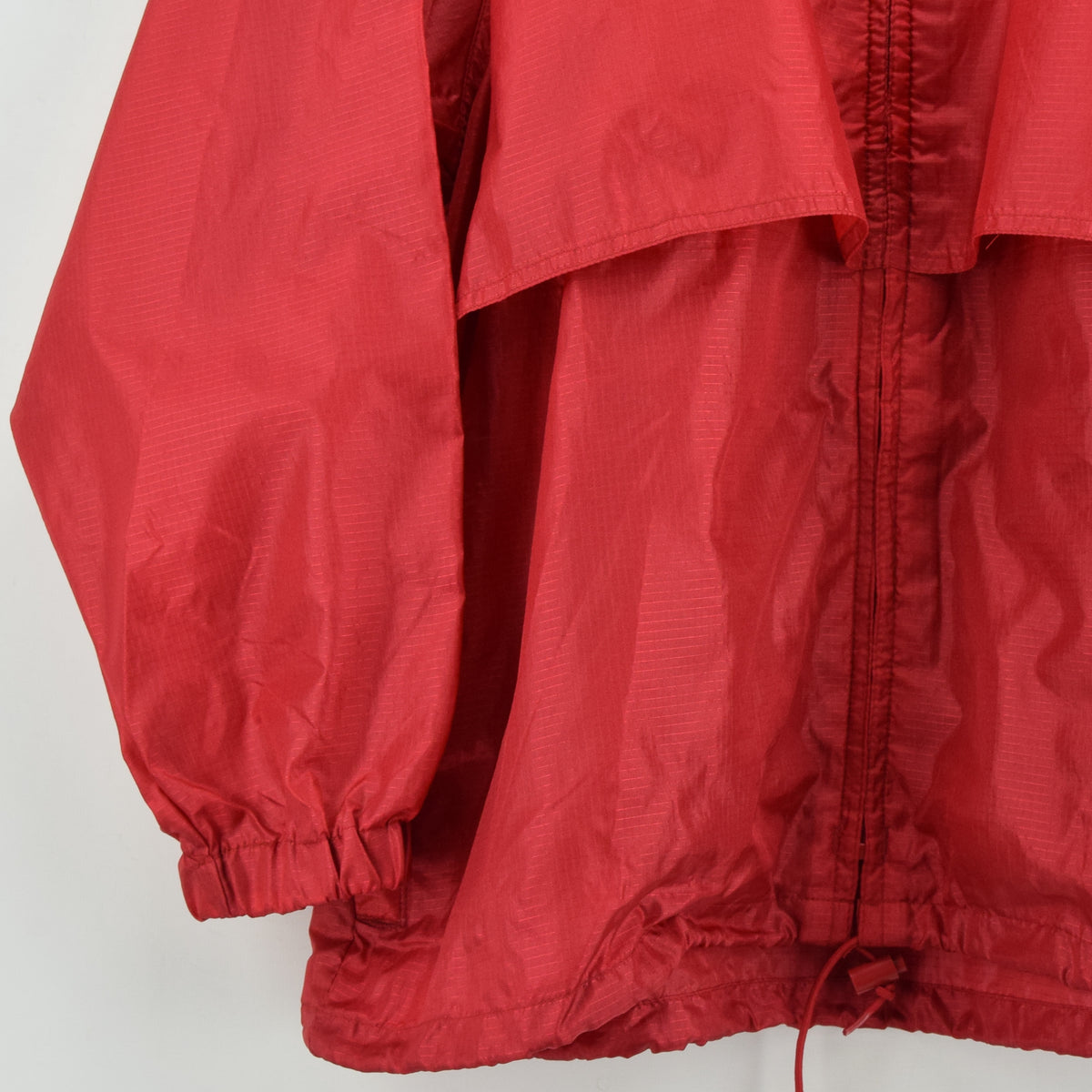 Eddie Bauer Red Hooded Nylon Ripstop Packaway Cagoule Jacket L front hem