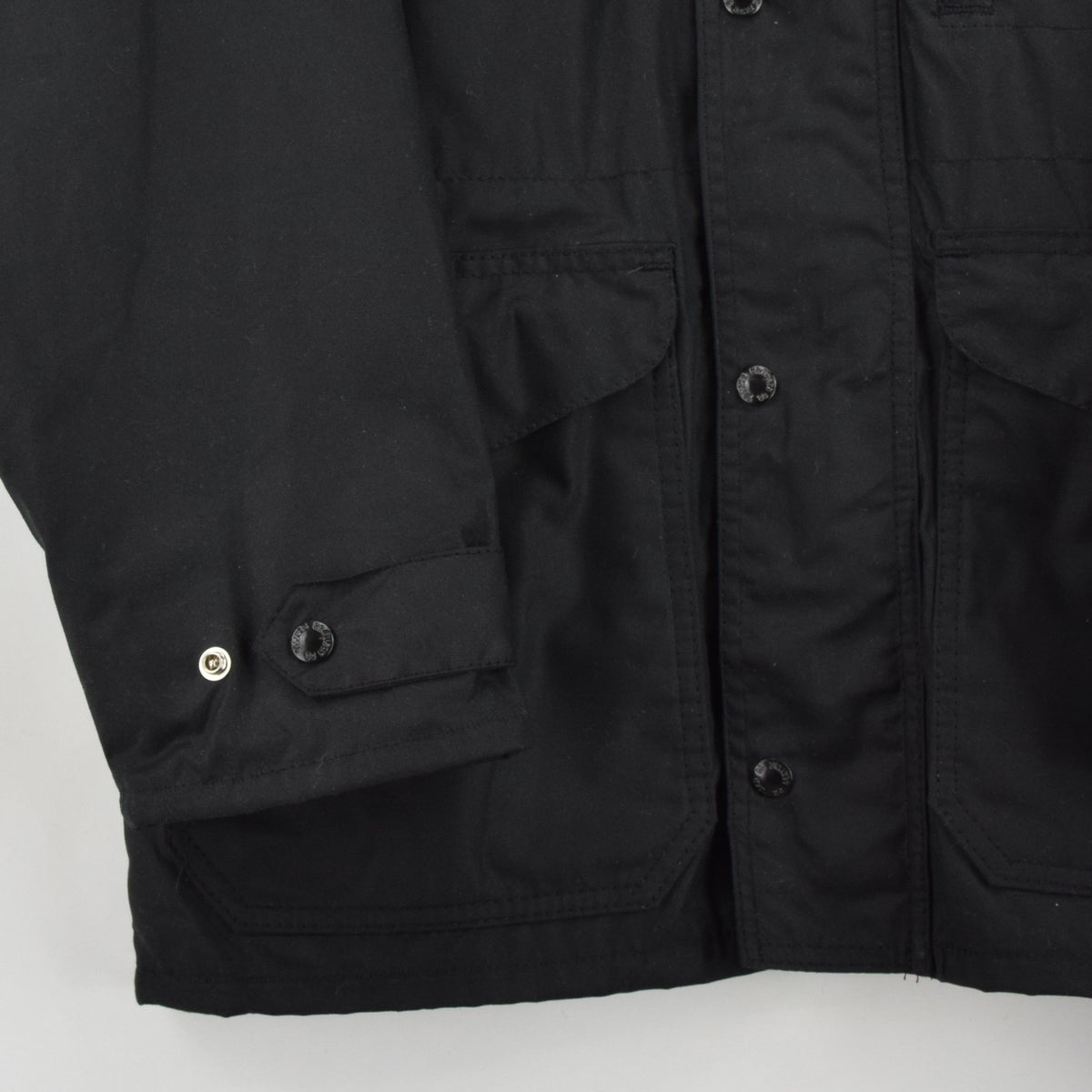 Filson Cover Cloth Mile Marker Coat Black Wax Cotton Jacket Made in USA M front hem
