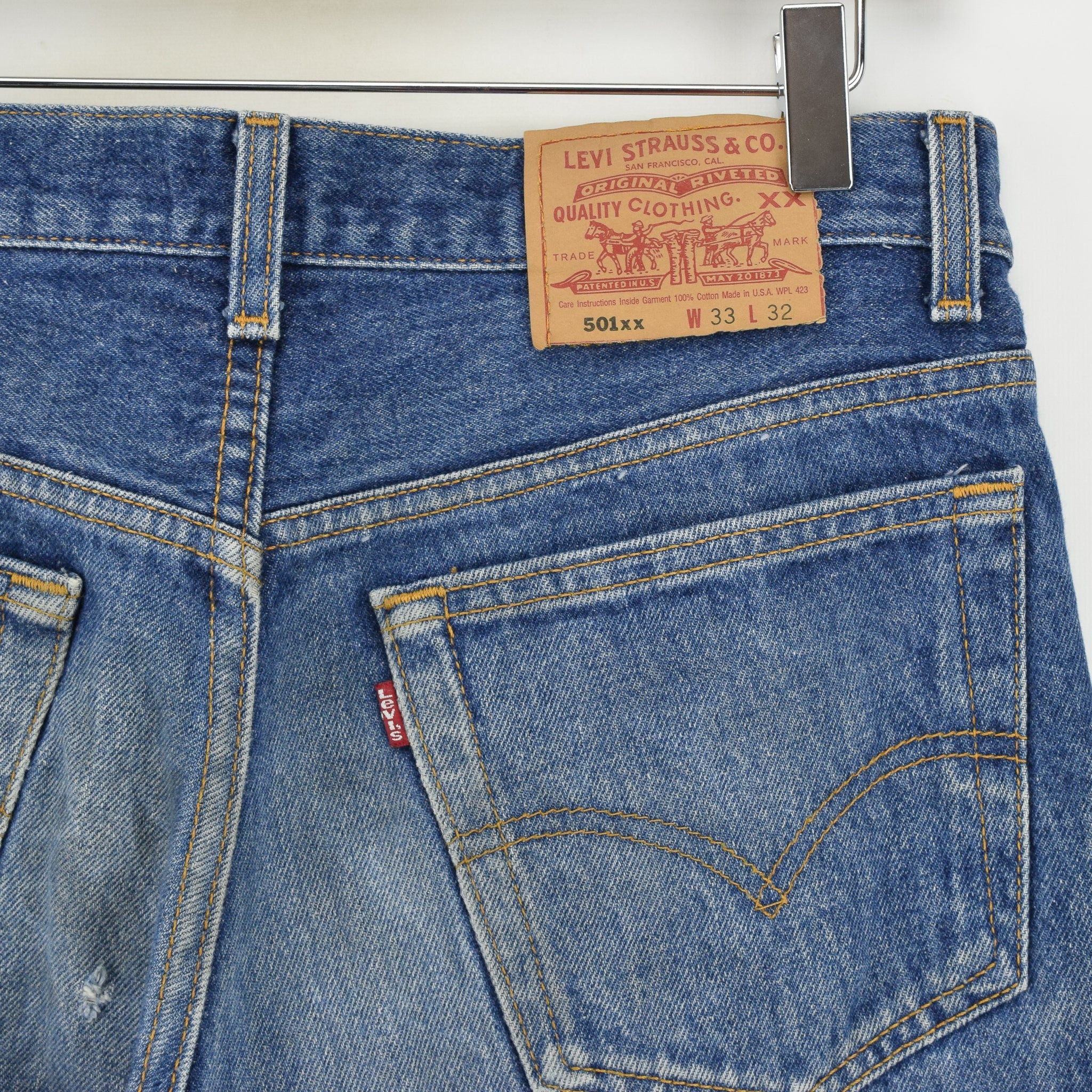 Vintage Levi Red Tab 501xx Stonewash Blue Denim Jeans Pant Made in USA 30 W 30 L back waist pocket badge