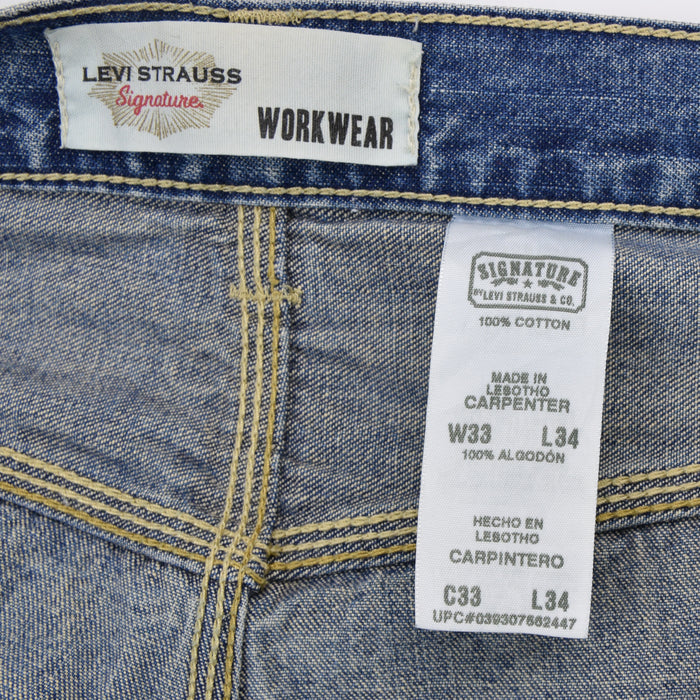 Vintage Levi Signature Blue Denim Jeans Carpenter Work Trousers 33 W 34 L label