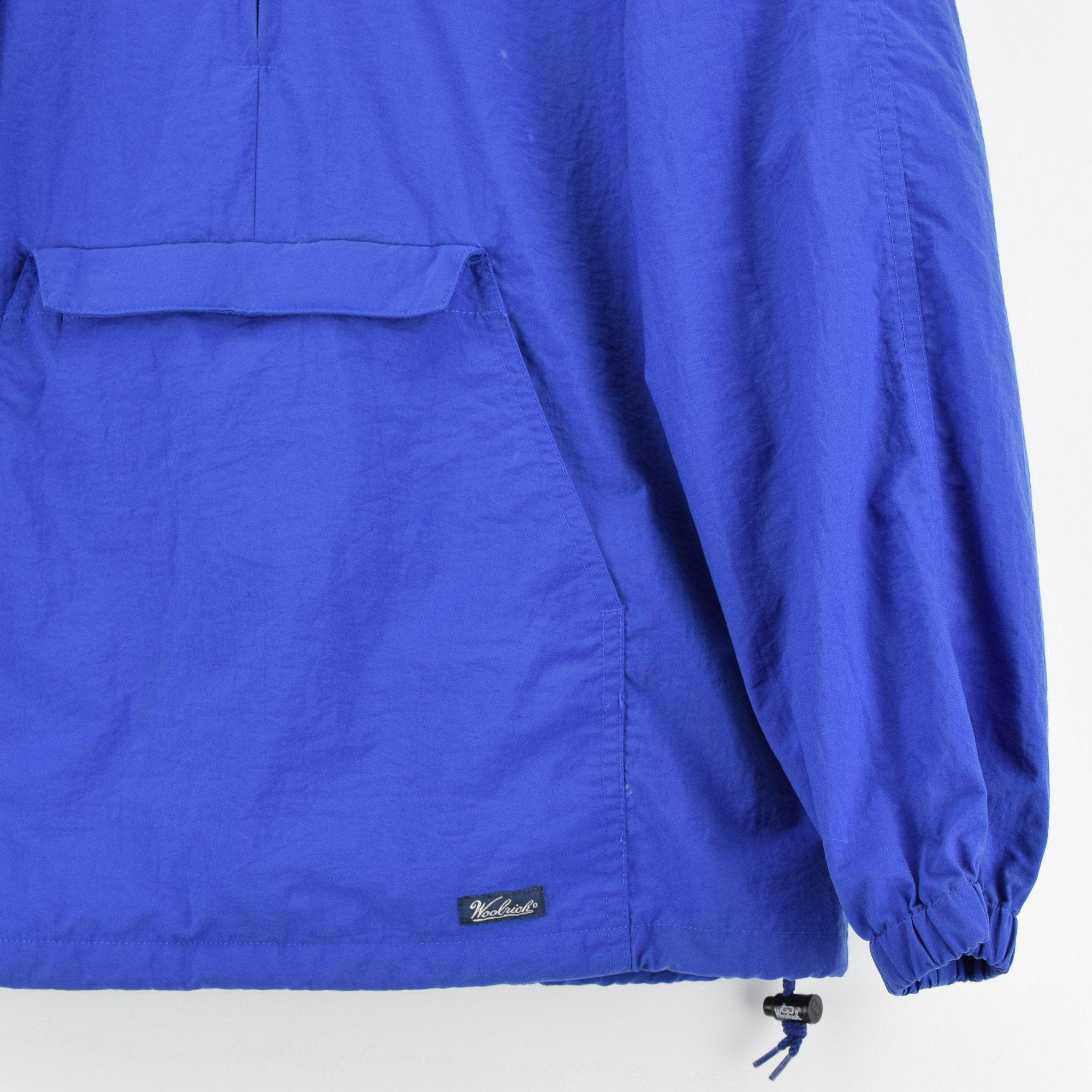 Woolrich Bright Blue Hooded Nylon Packaway Cagoule Unisex Jacket S front hem