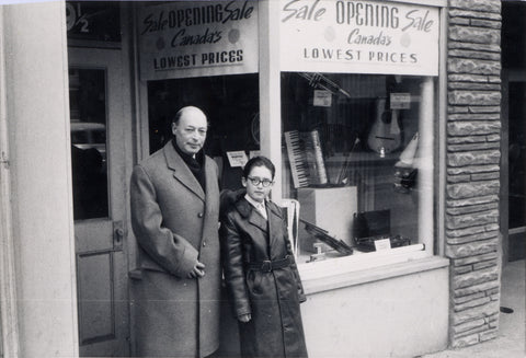 Zoltán Reményi and his son stand outside the Toronto shop during the April 1959 opening
